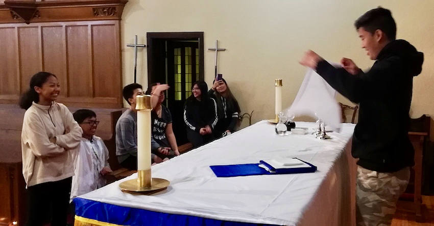 Youth practicing at the alter