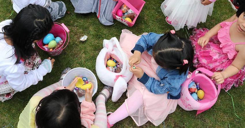 Children eating Easter chocolates